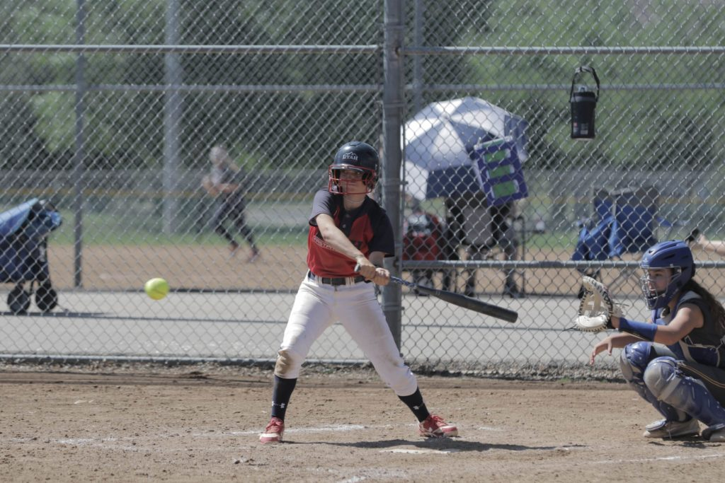 fastpitch softball player batting